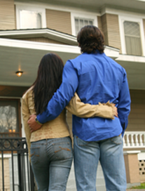 People - Young Couple and First House - Real Living Real Estate
